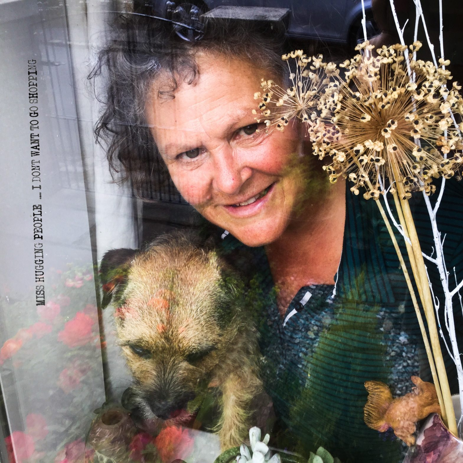 Person with dog behind a window